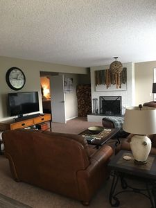 Large living area with wood burning fireplace. Firewood supplied
