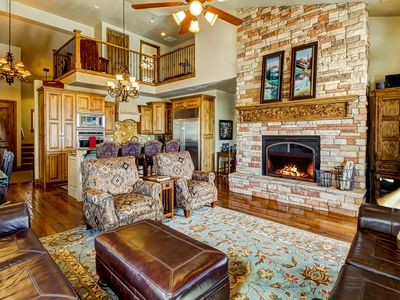 Photo for Stunning lakeview townhome with hot tub offers easy access to skiing and lake!