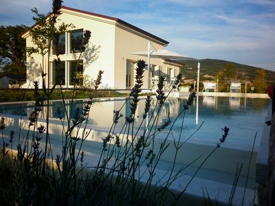 Photo for Villa with pool immersed in Le Marche hills: large garden, Jacuzzi+sauna & other