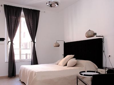 A Guest room at the RetRome Colosseum Garden. Large screen T.V, DVD, WIFI, A/C