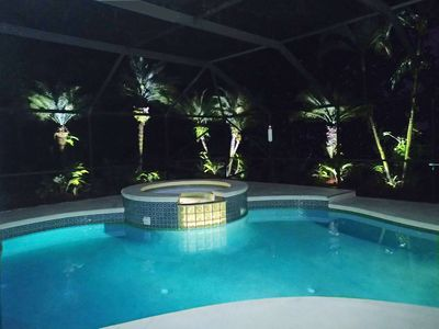An evening in the hot bubbling spa under the romantic lighting around the pool.
