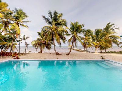 Photo for Beachfront condo w/shared pool, private beach - away from the bustling town!