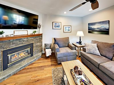"""Living Room - Curl up next to the gas fireplace and stream Netflix shows on the 55"""" smart TV."""