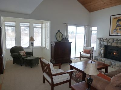 Family room, high Ceiling, TV inside the cabinet, gas fire place