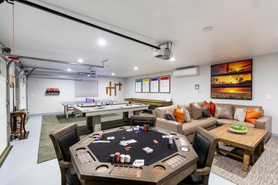 Additional game room with multiple gaming tables including poker and billiards.