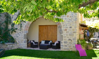 Photo for Holidays in Lagrasse. Stunning medieval apartment set in walled garden with pool