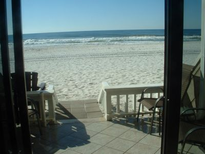 View out the sliding door to beach .  NO steps