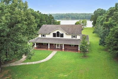 Welcome!  This house is nestled on 8 acres of land!