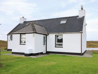 Photo for LOCHSIDE COTTAGE, pet friendly, with a garden in Grimsay, Ref 985763