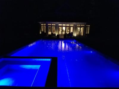 Pool and rear of house at night.