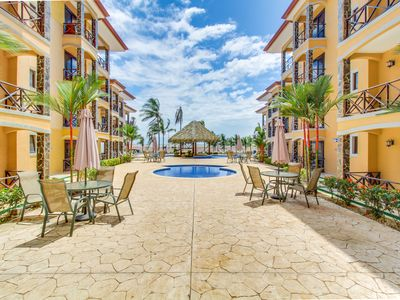 Photo for Two lovely oceanfront condos with shared pool, easy beach access, & more!