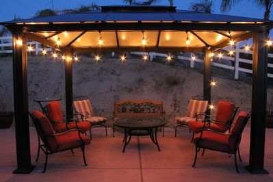 Evening relaxing on the back patio, wine in hand...