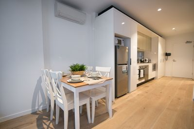 A fully decked & equipped kitchen & dining.