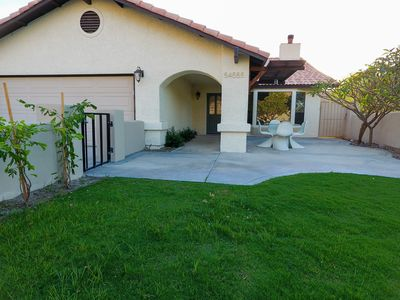 Front property with large grass gated area
