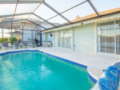 Photo for Beautiful 4 Bedroom Home Sunset Lakes