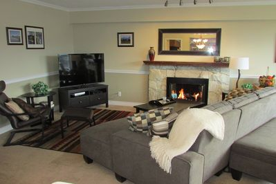 Large Living Room with Gas Fireplace,adjoining Dining Room and Sunny Sundeck