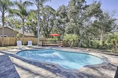 Relax in your own outdoor oasis at this 4-bedroom, 2-bath Palm Harbor home!