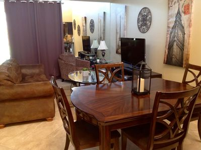 Dining table has leaf and seat up to 6
