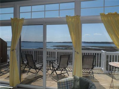 Photo for Amazing views of the bay and ocean great decks.end unit.  9WE