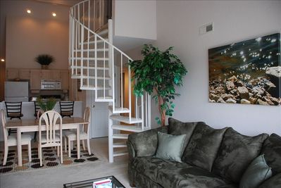 Main living area includes cath.ceiling, fireplace & 42' flat screen TV/DVD/VHS