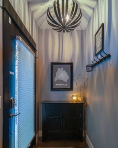 Front door enters into a small foyer.  A place to hang your hat or coat.