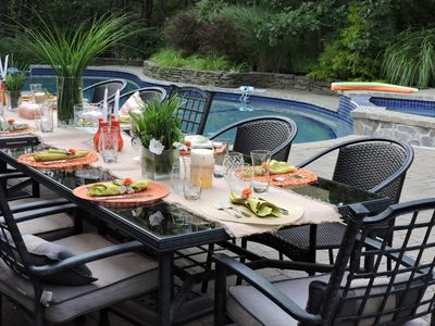 Dine & sunbath poolside  with seating for 20 + in a very private back yard.
