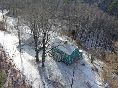 A drone view of our house with our 2 Wolf Trees in front.