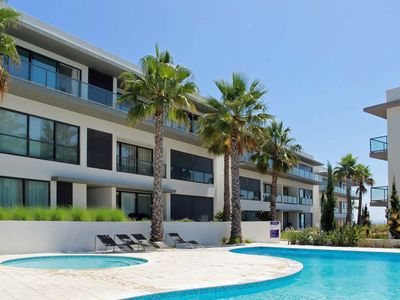 Photo for Very sunny upscale apartment with beautiful sun terrace, very close to the beach