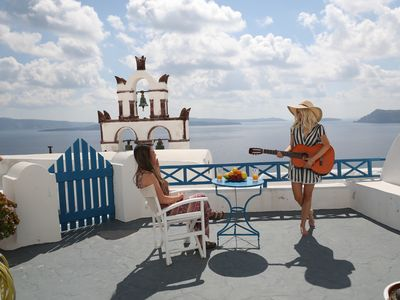 Photo for SantoriniParadise: BLUE & WHITE cave house, authentic experience, Caldera view