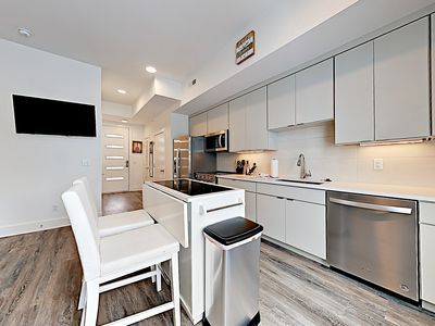 Kitchen - A full suite of stainless steel appliances awaits in the open-concept kitchen.