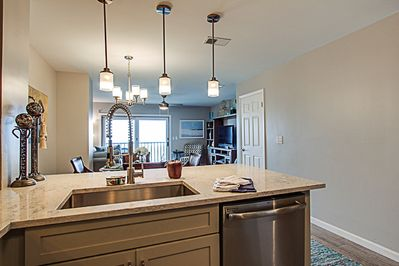 Granite countertops, stainless appliances. Watch the waves while you make dinner