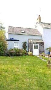 Photo for Cosy romantic cottage near Pembrokeshire border with enclosed large garden