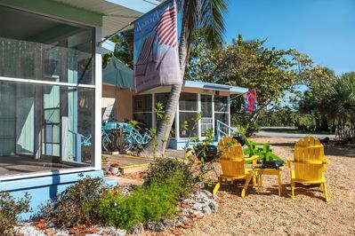 the Ibis cottage exterior lanai and adirondack chairs.