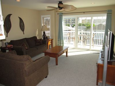 Living room. Sofa and love seat. Pull up table.