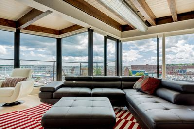 Large living area with expansive views of harbor and city.