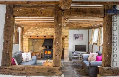 Stunning living room, with a large inglenook fireplace and a cosy wood burning stove