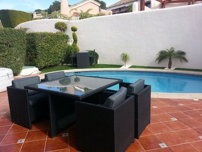 Terrace with ample dining and seating areas