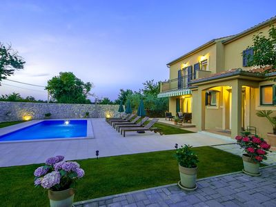 Photo for Villa with beautiful garden, private pool, summer kitchen, 14 km from Porec and beach