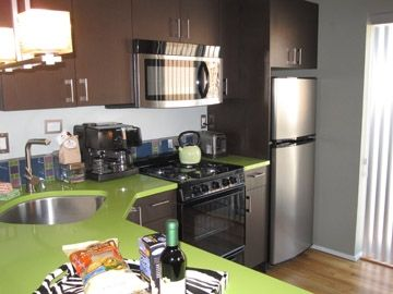 fully equipped kitchen with colorful Silestone counters