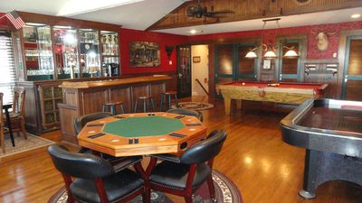 Game Room/Bar (1100 sq ft) Pool table, air hockey, game tables, & more!