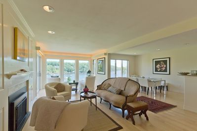 Living & dining rooms with wall to wall views of harbor. Open floor plan & flow.