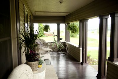 Inviting front porch available to guests, perfect to sip coffee, listen to the song birds and enjoy the view.