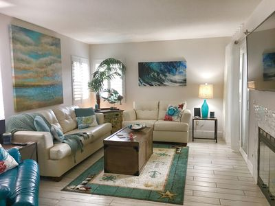Living Room: 50in HD TV, fireplace, patio access