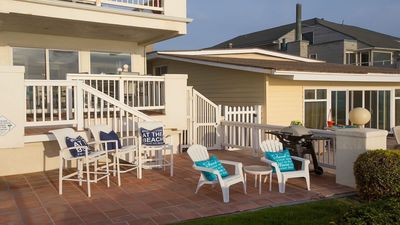 Enjoy dining on the deck and relaxing on our Patio steps from the beach!