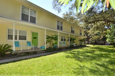 4 Townhomes with front porches and a large deck with gas grill and yard