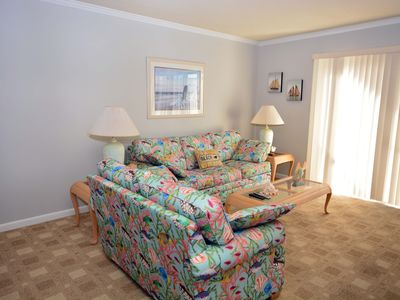 Photo for Spacious, quaint 2 bedroom with free WiFi and an indoor and outdoor pool located uptown on the ocean block just a short walk to the beach!
