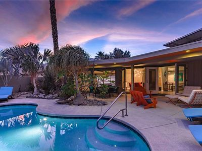 Photo for Relax by the pool in your private back yard and enjoy the breathtaking mountain views.