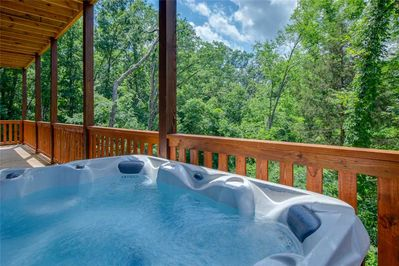 Come on in, the water's fine! - In addition to the indoor pool, Majestic Waters has a hot tub on its lower deck. What a wonderful spot for unwinding under the stars at the end of another action-packed day!