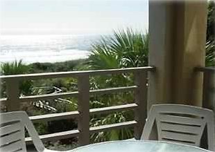 Balcony off living room with ocean view.