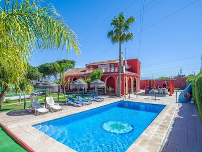 Photo for SPORTING VILLA, WALK INTO TOWN,FENCED POOL WITH GATE,  WIFI , AIRCON,NEAR GOLF.,